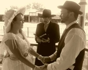 A couple of sophisticates getting married in Tombstone.
